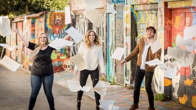 Students looking happy in an alley